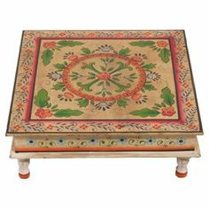 Create a stunning focal point in your conservatory or lounge with this hand-painted wood table, featuring traditional Indian designs. Team with matching accents and dark wood furniture to complete the look.   Product: TableConstruction Material: WoodColour: CreamFeatures: Hand-paintedDimensions: 15 cm H x 45 cm W x 45 cm D