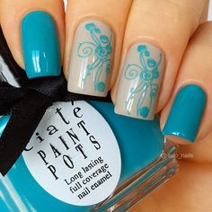 Aqua nails with white and turquoise accent stamps. (by @solo_nails on IG)
