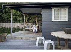 exterior weatherboard painted in Dulux Domino (alternatives Dulux Maximus or Dulux Companion). Swing chair from Orient House