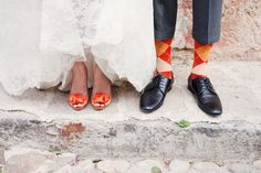 Shoes for the bride and socks for the groom in a matching orange color