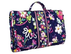 Vera Bradley Baby Changing Pad Clutch in Ribbons. Designed for quick changes, this pretty little clutch opens to reveal an extra-large changing pad, a mesh pocket for wipes and a slip pocket for diapers.