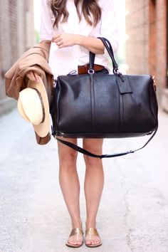 Black vegan leather travel bag. Perfect for weekend trips!