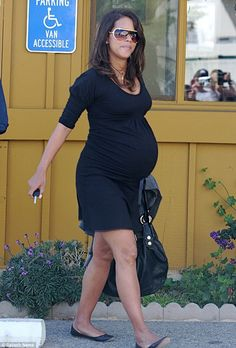 Expecting Nahla: Halle frequently stepped out in figure flattering dresses when she was pregnant with Nahla in 2008