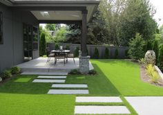 Simple, modern landscape with gray colored concrete and synthetic turf grass.
