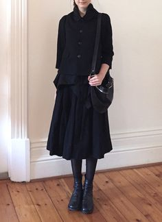 Comme des Garçons jacket, Paul Harnden skirt, Guidi bag and shoes.