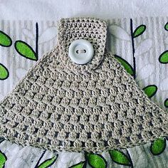Simple towel topper has been designed for those new to crocheting the tops of towels.
