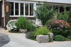 Front Yard Entrance - Curb Appeal - Planting, Interlocking Paver Front Walkway, Armor Boulders, Wood Porch | Yelp