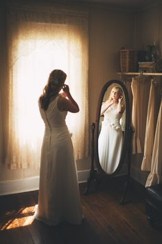 Bride getting ready, bride's reflection in mirror, natural light, wedding photography, country wedding pictures, vintage bridal shot