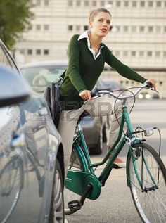 woman commuting on bicycle and looking away Stock Photo