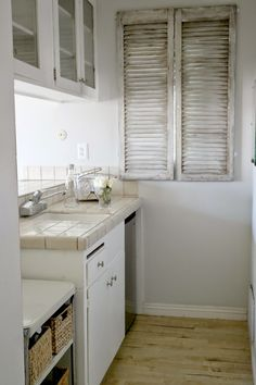 like shutters, but don't have the right house for them?...hang shutters over a window from the INSIDE...cool idea...