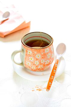 beautiful Orange with White Flowers. the spoon also matches.