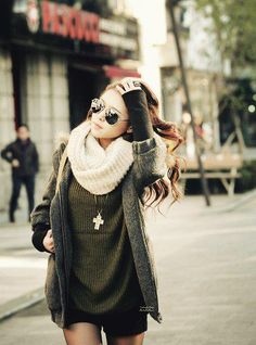 Fun combination. Looks warm but I never understand the sweater with the shorts style. Why wear a sweater if it's hot or shorts if it's cold?
