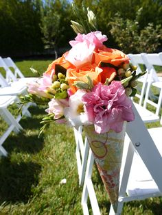 Beautiful aisle arrangement with pink and orange flowers. #Weddings by Michael Daigian Design