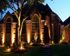 Red Brick With Area #Lighting And A Large Tree By Nite FX #Landscape  Lighting