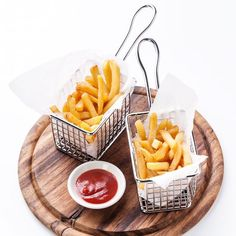 French Fries presented in Stainless steel waffle grid mini fryer baskets.