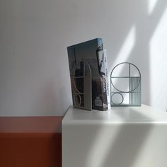 ferm LIVING Bookends: http://www.fermliving.com/webshop/shop/office.aspx
