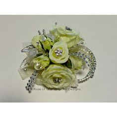 'Divine' in Fayetteville Ar, Rose of Sharon Floral Designs. A gorgeous combination of miniature roses with diamond accents.