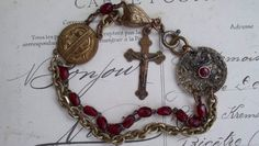 Repentant - Vintage Assemblage Bracelet with Ruby Red glass Rosary Beads by VintageTraveler on Etsy https://www.etsy.com/listing/127939757/repentant-vintage-assemblage-bracelet