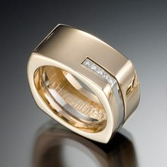Quattro Ring: Substance and style. The Quattro men's ring features clean lines of 14kt yellow gold with white gold accent, featuring .08 carats total of VS G diamonds.