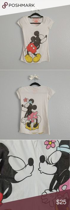 "disney couture mickey and minnie tee disney couture short sleeve t-shirt featuring mickey and minnie mouse kiss. the print wraps around the side, exposing only mickey mouse on the front and minnie mouse from the back. the softest shirt!  size small length - 23.5"" bust - 15"" waist - 14"" Disney Tops Tees - Short Sleeve"