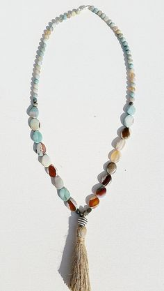 Beautiful tassel necklace handmade by an artist with developmental disabilities. 100% of purchase goes directly to Evergreen Life Services charity