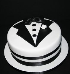 "A 10"" chocolate biscuit cake with hand cut Tuxedo details to celebrate the union of George & Billy."