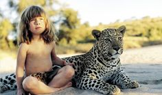 """Tippi Degré has been dubbed the """"real life mowgli,"""" as she was raised amongst wild animals. The pictures and the story of her childhood are astonishing."""