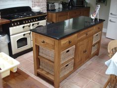 Lovely oak island with 4 baskets and granite worktop.