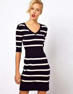 Breton Stripe Knitted Skater Dress - style: jumper dress; length: mid thigh; neckline: v neck; fit: fitted at waist; pattern: horizontal stripes; waist detail: wide waistband/cummerbund; predominant colour: navy; occasions: casual, evening, work; fibres: cotton - stretch; hip detail: ruching/gathering at hip; sleeve length: half sleeve; sleeve style: standard; texture group: knits/crochet; trends: striking stripes; pattern type: fabric; pattern size: small & light