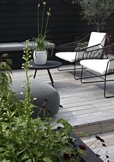 Black metal frame lounge chairs with rope side detail I Out on our terrace