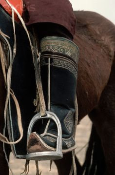 Mongolian Boot in Horse Stirrup. Photographer:Brian A. Vikander