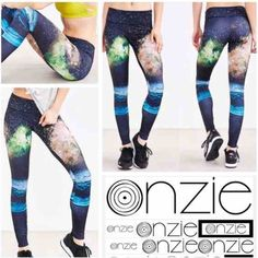 Onzie Space Galaxy Workout Leggings this boldly printed Placement Print Legging Free Fly. Tag Size is M/L Features Long leggings. Graphic placement print. Thick flat waistband for a comfortable fit.  Details Designed For: Heated Yoga, All Yoga Types Fabric(s): 80% Nylon, 20% Spandex Fit: Tight Rise: Mid-Rise Length: Ankle Onzie Pants Leggings