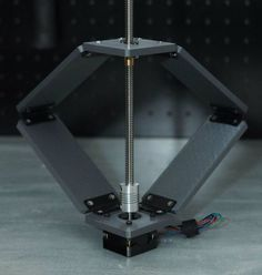 Low-Cost Linear Actuator Based on the Sarrus Linkage