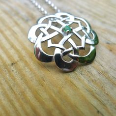 At first look it's a flower. Look again, and it becomes geometric. Celtic design at its finest. Set with an Emerald Celtic Spiral, Celtic Knot, Ying Yang Symbol, Celtic Necklace, Celtic Wedding Rings, Celtic Designs, Claddagh, Stone Carving, Unique Rings