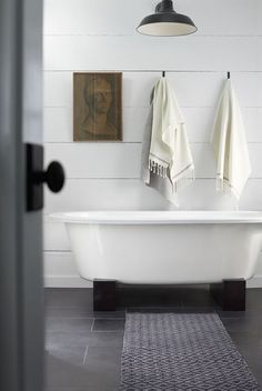 lovely example of a super simple, modern bathroom. I like the wood boards.