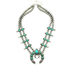 """Squash Blossom Necklack A squash blossom necklace is a must-have boho piece. These vintage-inspired necklaces just arrived and are stunning, so get yours before they're gone! Approximately 15 1/2"""" wit"""