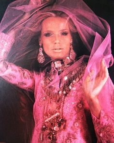 Sari styled dress on 1960s model Veruscha in bright pink with awesome bling