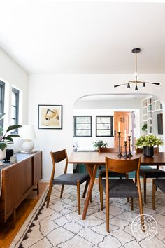 Dining table & chairs: West Elm Pendant: Lawson-Fenning Credenza: Lawson-Fenning Rug: Vintage from Chairish