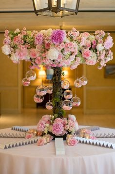 Wedding Designs Escort cards surrounded a pink floral arrangement embellished with glass orbs. Reception Decorations, Event Decor, Wedding Centerpieces, Wedding Table, Table Decorations, Wedding Ideas, Centrepieces, Wedding Entrance Table, Quinceanera Centerpieces