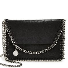 """Stella McCartney Mini Falabella cross-body. Black Gorgeous Stella McCartney """"mini Falabella shaggy deer"""" cross-body bag in faux leather. Absolutely gorgeous. 8""""w X 5 3/4""""h X 1/4"""" deep. Strap is 21"""" -- can also be worn as a clutch or shoulder bag. Pristine condition. Dust bag included. Stella McCartney Bags Crossbody Bags"""