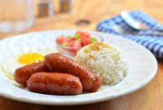 Longganisa...A typical Filipino breakfast - sweet sausages, garlic fried rice and sunny side up eggs! Yum! #longganisa #sausages