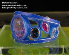 Hand carved wax to be made into a multi-gemstone ring. McNulty Jewelers original design