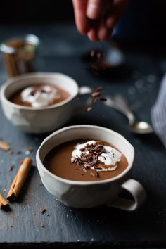In this dairy-free champurrado, almond milk forms the base for spicy vegan hot chocolate thickened with masa harina and topped with whipped coconut cream. Vegan Hot Chocolate, Mexican Hot Chocolate, Cacao Chocolate, Bojon Gourmet, Le Cacao, Coconut Whipped Cream, Latte Macchiato, Chocolate Shavings, Creme