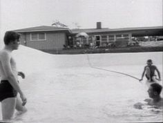 Going into his half-filled newly-built swimming pool on Audobon Drive. They had been running a garden hose from the kitchen sink for six hours to fill up the pool. Haha.