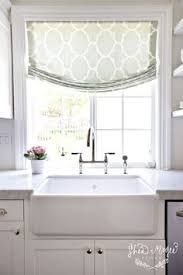 source: Shea McGee Design website Sun filled kitchen features window covered in Windsor Smith Riad Fabric in Seafoam over farmhouse sink accented with polished nickel bridge faucet. - for kitchen sink window Style At Home, Kitchen Sink Window, Kitchen Windows, Kitchen Sinks, Kitchen Blinds Above Sink, Kitchen Window Curtains, Bathroom Blinds, White Farmhouse Sink, Farmhouse Style