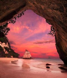 Cathedral Cove, Coromandel Peninsula, New Zealand #travel #newzealand #sunset #pink #cave #beautiful #gorgeous #dusk