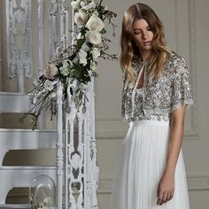 All that glitters ☄Our Silver Scallop Maxi Dress, £275,features our signature silhouette. The fully layered tulle skirt creates the all-important romantic movement, whilst the fitted embellished bodice sparkles and glistens beautifully. Perfect for your aisle entrance. [📷: Silver Scallop Cape £225 at needleandthread.com] 🌿🌸👰🏼🌸🌿