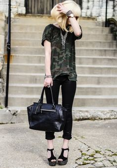 I like this look the black cropped trousers and camouflage tshirt go well x