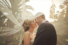 Incredible shot under the bride's veil | Orange Turtle Photography via Bridal Musings