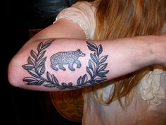 Small Bear And Leaves Tattoo On Arm